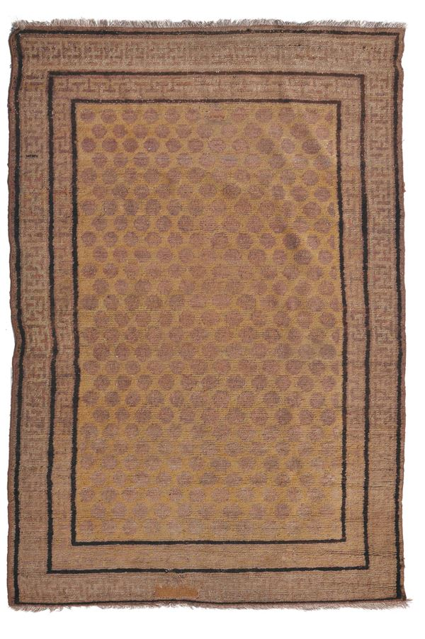 Hotan rug late 19th century.Overall good condition.