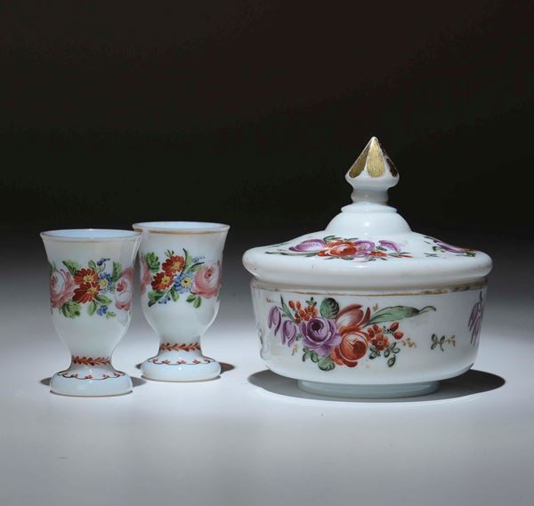 A lot formed by a pair of small blown glass glasses and sugar bowl. Bohemia, 19th century