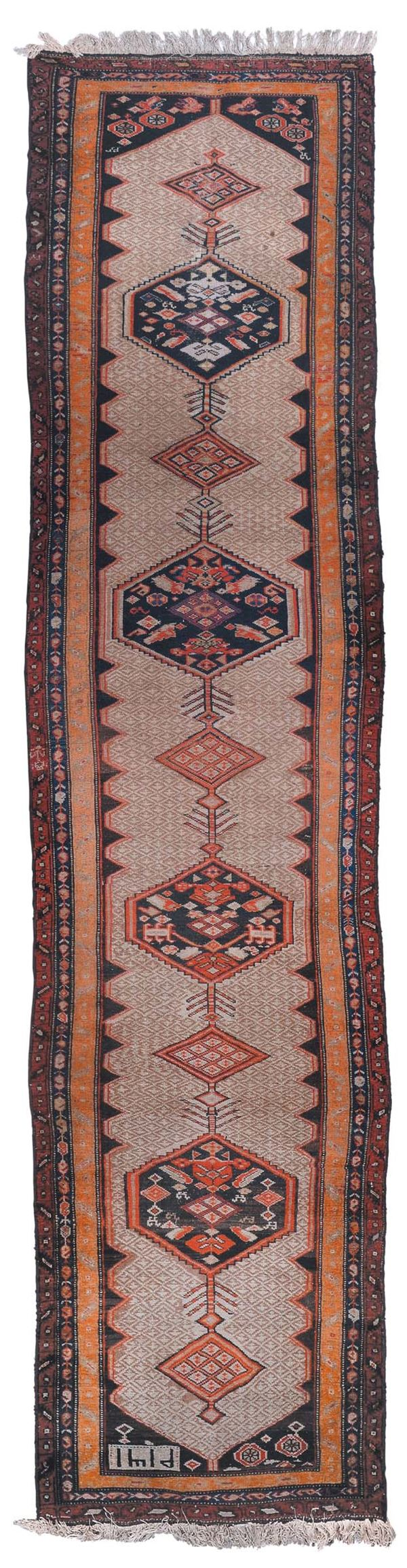 A Northwest Persian runner late 19th century.Dated 1319 good condition.