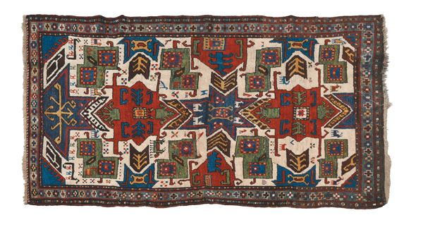 A Caucaso Star Kazak rug end 19th early 20th century.One the end is restored.