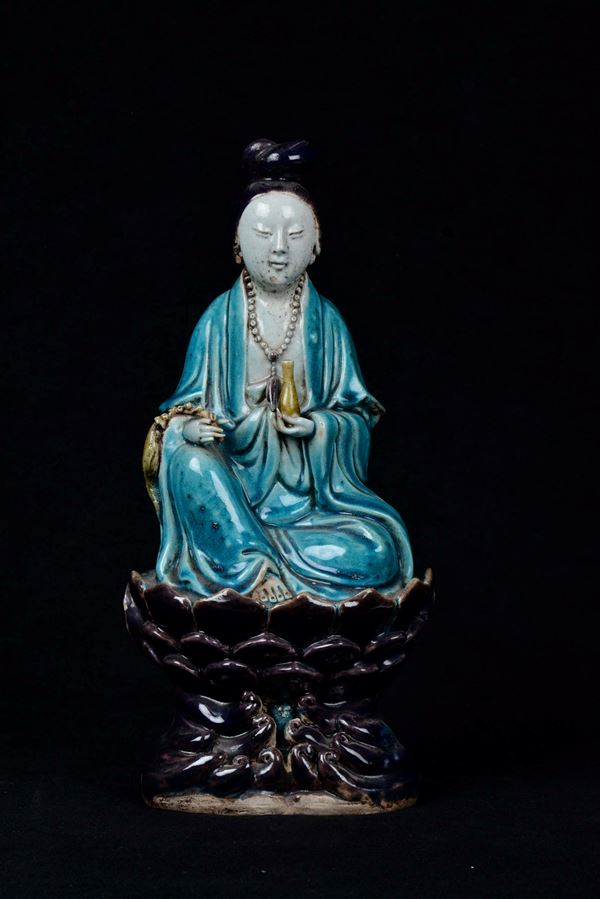 A polychrome enamelled porcelain sitting Guanyin on lotus flower, China, Qing Dynasty, Kangxi Period (1662-1722)