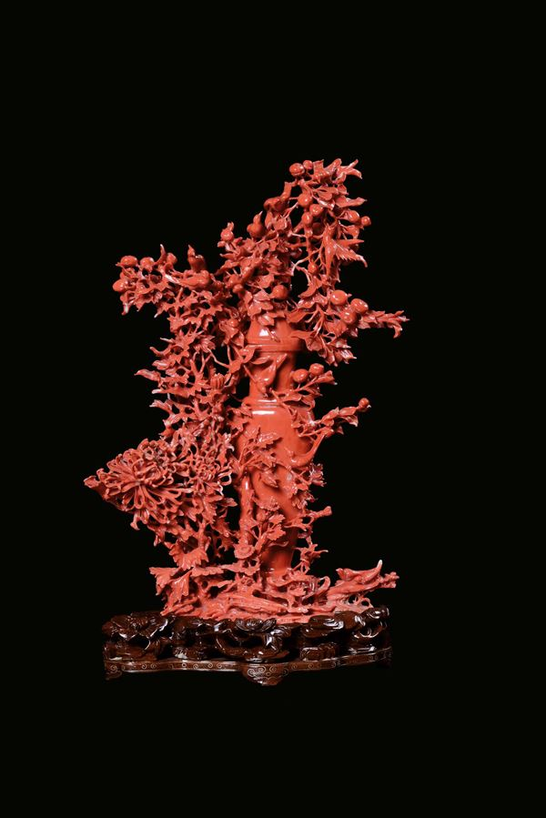 A red coral vase representing richly carved vegetation, fruit and birds, China, beginning 20th centur [..]