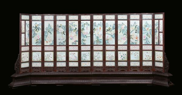 An important 12-shutter Homu wood screen and 64 polychrome porcelain plaques, China, Qing Dynasty, Jiaqing  [..]