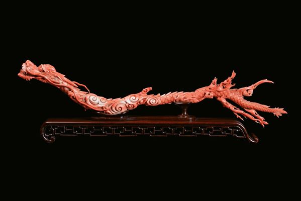 A rare and large red coral branch sculpted as a dragon, China, Qing Dynasty, 19th century