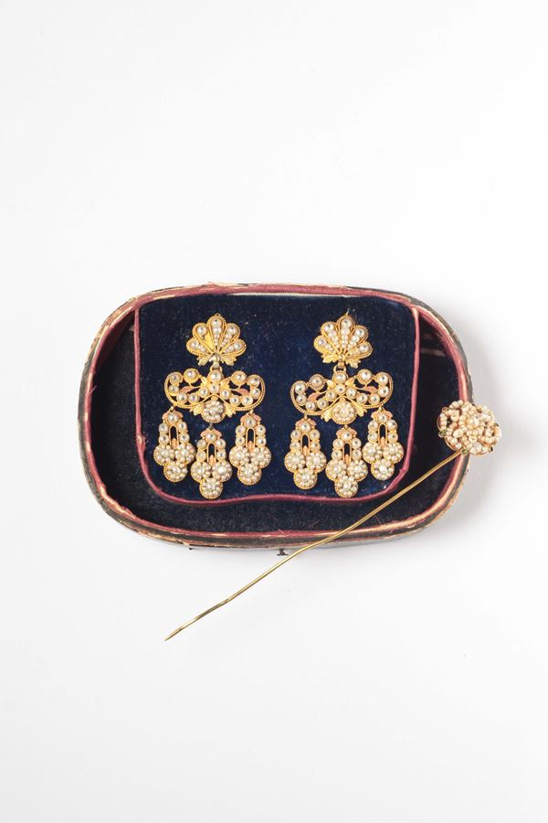 A 17th century pair of seed pearls and gold earrings