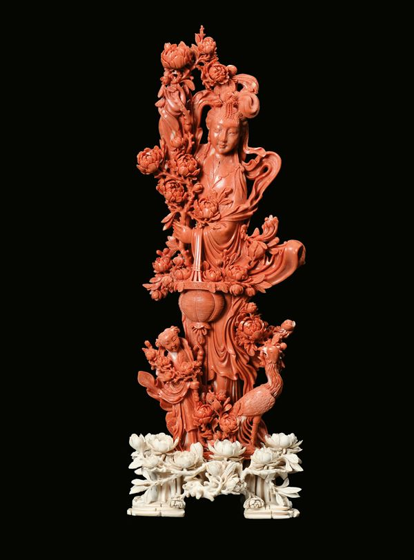 A carved red coral figure of Guanyin and other characters, China, Qing Dynasty, late 19th century