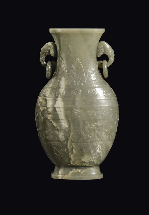A large Celadon jade vase with archaic decoration, China, Qing Dynasty, Jiaqing Period (1796-1820)