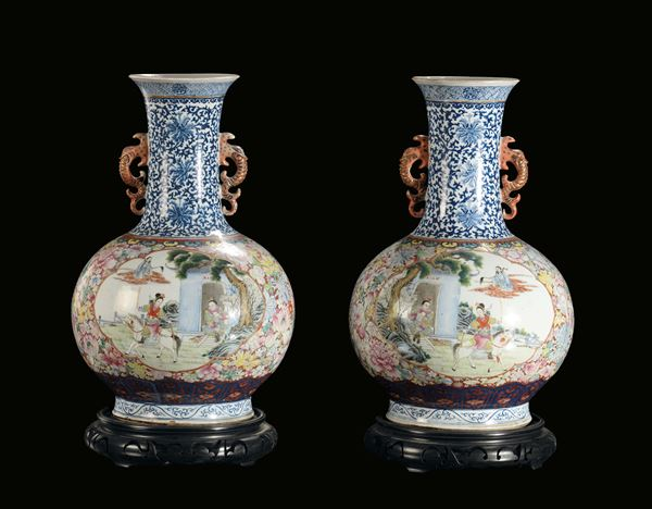 An important pair of polychrome porcelain ampoule vases decorated with oriental life scenes, China,  [..]