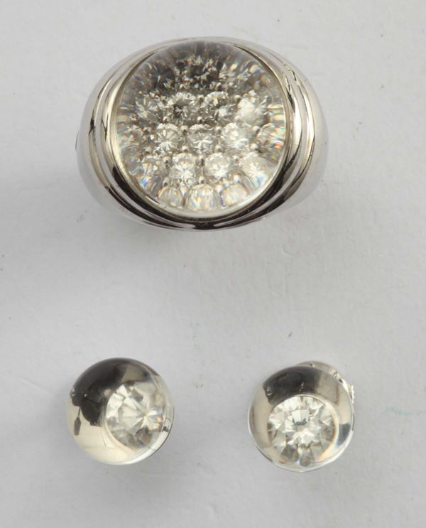 Rock crystal and diamond ring and a pair of earrings, Maubussin