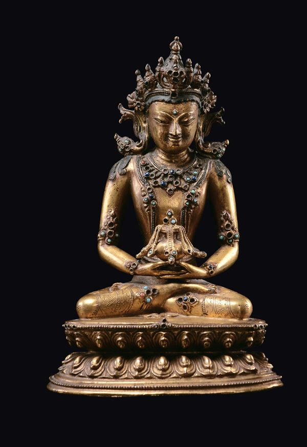 A gilt bronze Amitayus figure seated on a double lotus flower base, China, Qing Dynasty, 18th century [..]