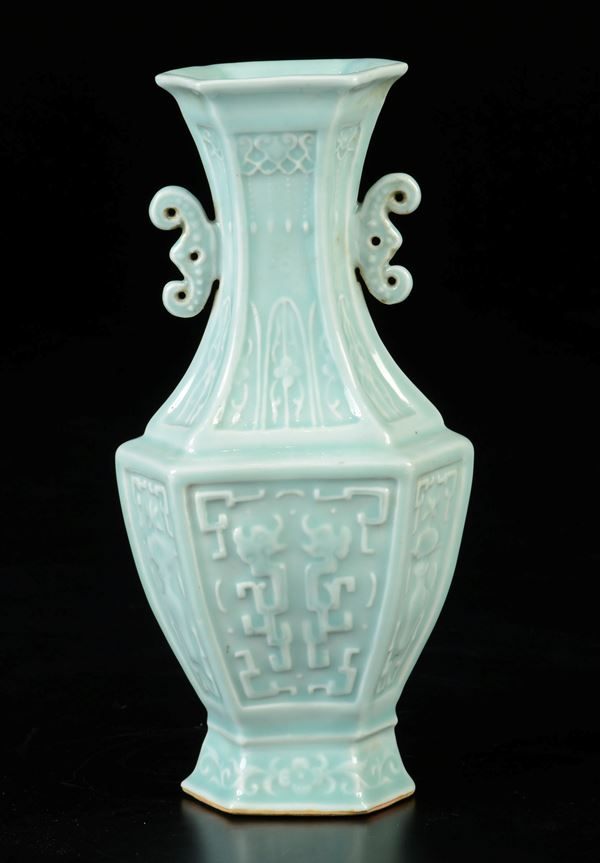 A Celadon porcelain hexagonal based vase with decoration in relief, China, Qing Dynasty, 19th century