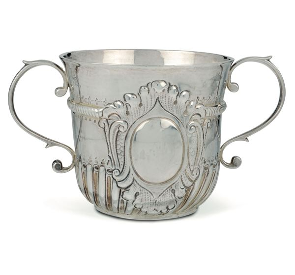 A molten, embossed and chiselled silver Porringer, silversmiths Robert Timbrell and Joseph Bell I, London 1714