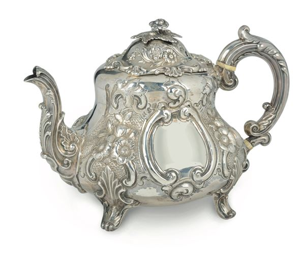 An embossed, molten and chiselled silver tea-pot, silversmith Richard Hennez, London 1863