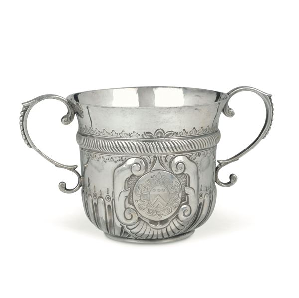 An embossed and chiselled silver porringer, England 1706