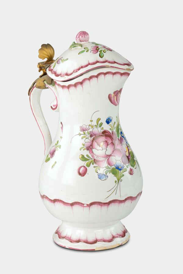 A polychrome majolica ewer and cover with rose decoration, France, late 18th century