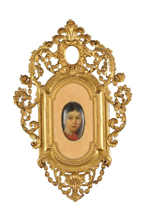 A small mould frame with carved and gilt wood decorations, late 18th century