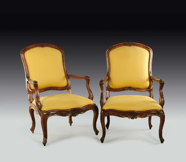 A pair of large Louis XV walnut armchairs, Genoa, late 18th century