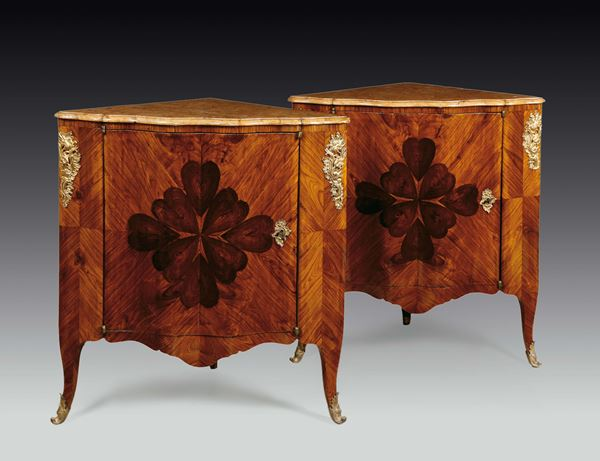 A pair of violet veneered and inlaid corner cupboards with a four-leaved clover motive, Genoa, 1860s