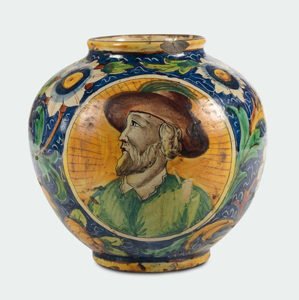A polychrome majolica pitcher vase with male profile within medallion, Sicily, 17th century