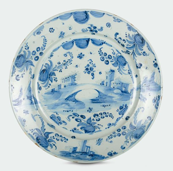 """A white and blue majolica plate with """"tapestry"""" decoration, Savona, late 17th century"""