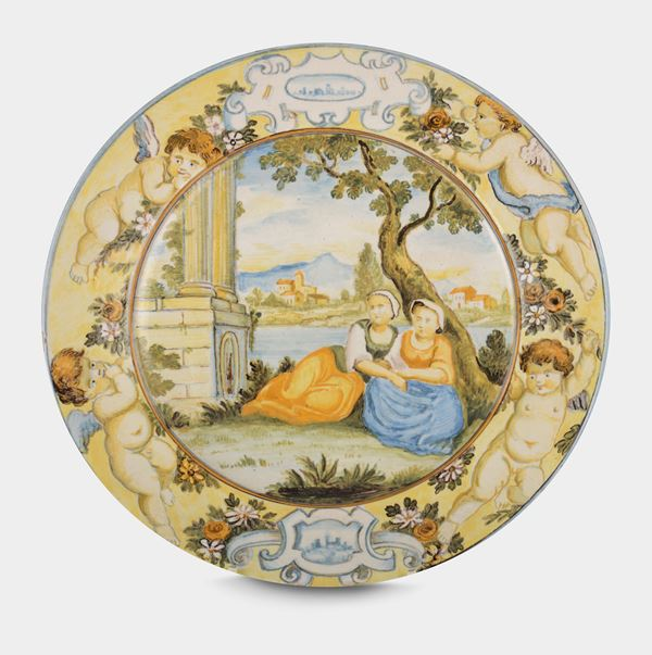 A small Castelli majolica tondo with two female figures in the middle and landscape, late 18th century