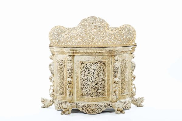 A carved and fretworked teak wooden ivory-glazed forniture, India, 19th century