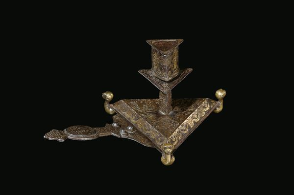 A forged iron and damascened brass table candlestick, France, early 17th century