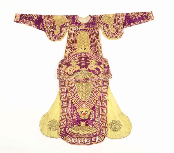 A silk violet-ground dress with golden dragons, China, Qing Dynasty, 19th century