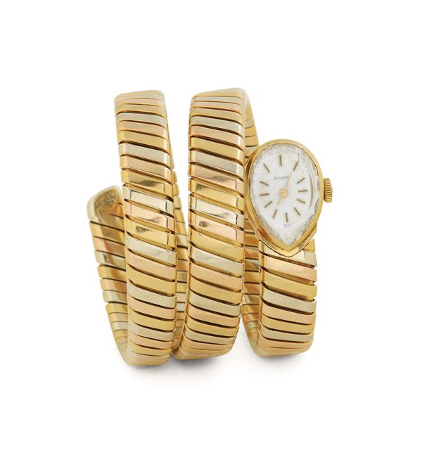 Bulgari, Ref. 1142210, 18K yellow gold lady's  wristwatch with an integrated 18K yellow, pink and white  [..]