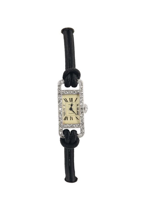 Cartier, France, 18K white gold, Art Deco, wristwatch with diamonds. Made in the 1920's.