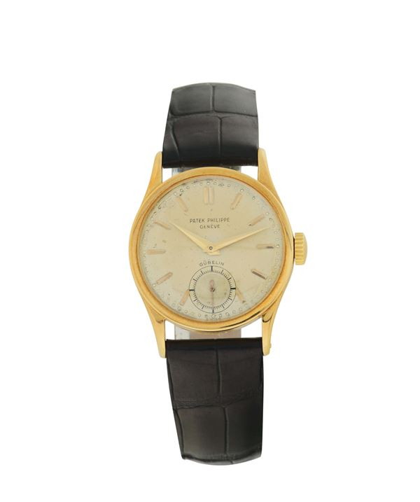 Patek Philippe, Geneve, Gubelin, movement no. 964720, cassa No. 301978, 18K yellow gold wristwatch with an 18K yellow gold buckle. Made in the 1950's.