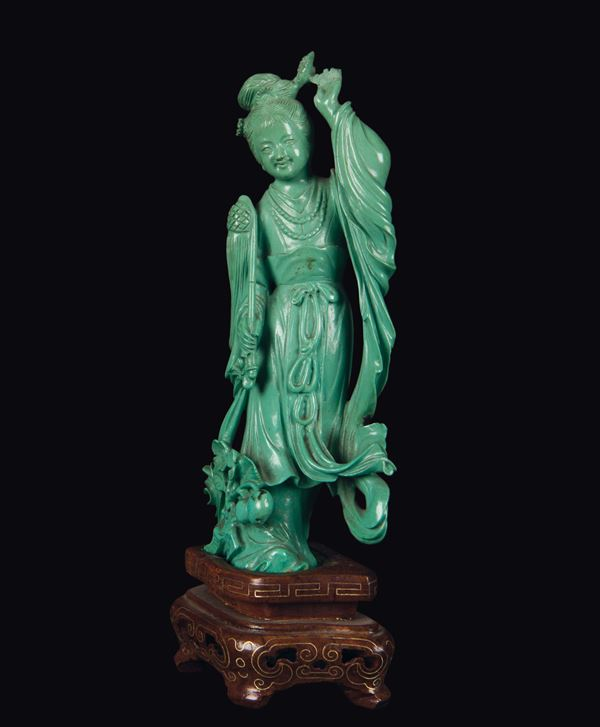 A small turquoise figure of Guanyin, China, Qing Dynasty, 19th century