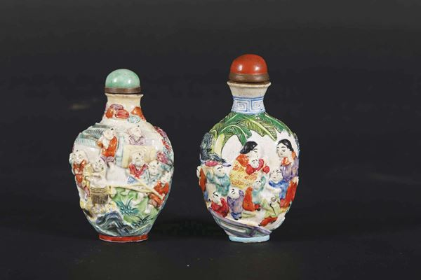 Two molded and reticulated porcelain children snuff bottles, China, Qing Dynasty, 19th century