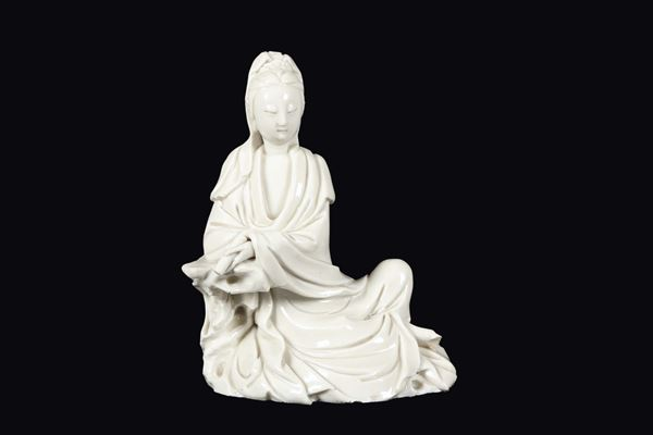 A Blanc de Chine Dehua seated Guanyin with scroll, China, Qing Dynasty, late 17th century