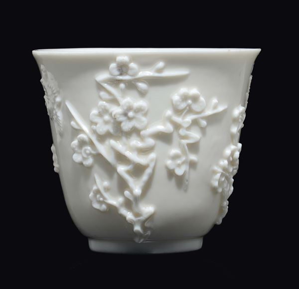 A Blanc de Chine Dehua wine vessel with cherry blossoms in relief, China, Ming Dynasty, late 17th century