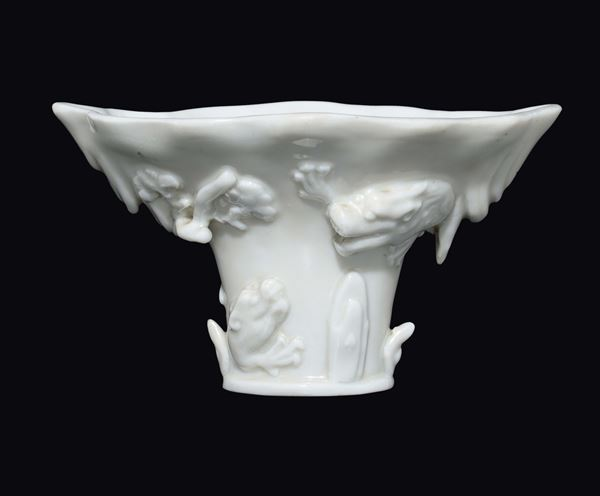A Blanc de China Dehua cup with animals in relief, China, Ming Dynasty, late 17th century