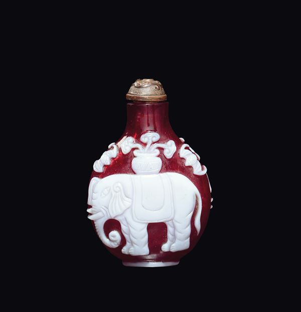 A white-overlay red Beijing glass snuff bottle with elephant, China, Qing Dynasty, 19th century
