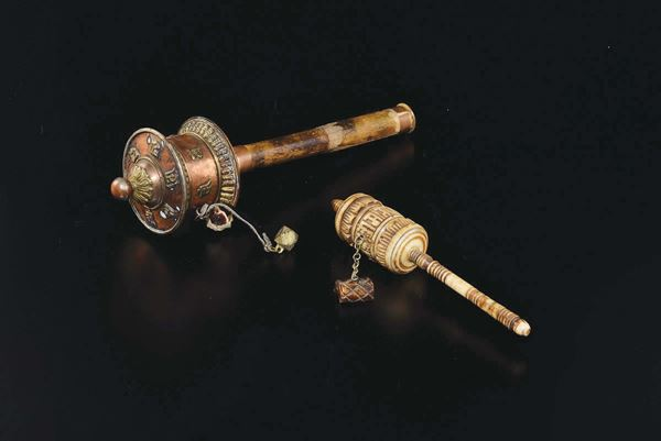 Two prayer wheels, a carved ivory and a copper one, Tibet, 19th century