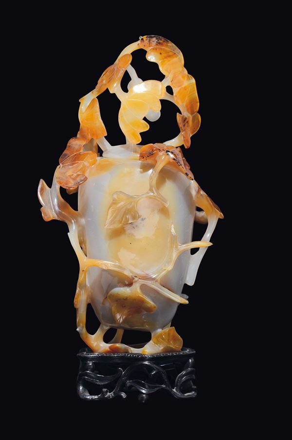 An agate vase and cover with branches in relief, China, Qing Dynasty, 19th century