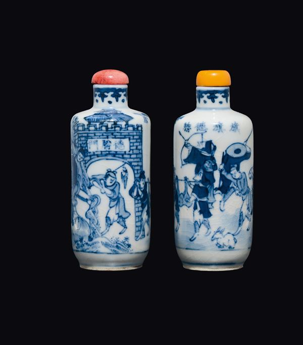A pair of blue and white snuff bottles with battle scenes and inscriptions, China, Qing Dynasty, 19th century