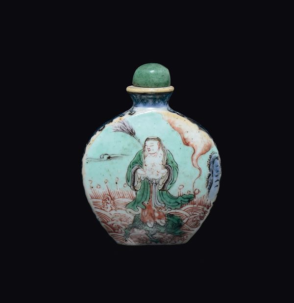 A polychrome enamelled porcelain wise man and children snuff bottle, China, Qing Dynasty, 19th century