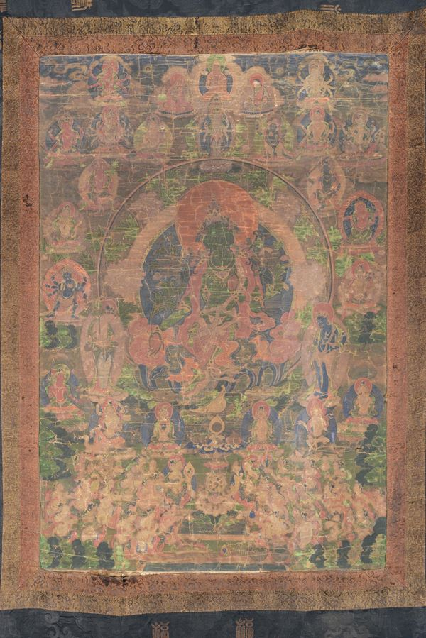 A blue and green-ground tanka with a central deity on a lotus flower, Tibet, 18th century