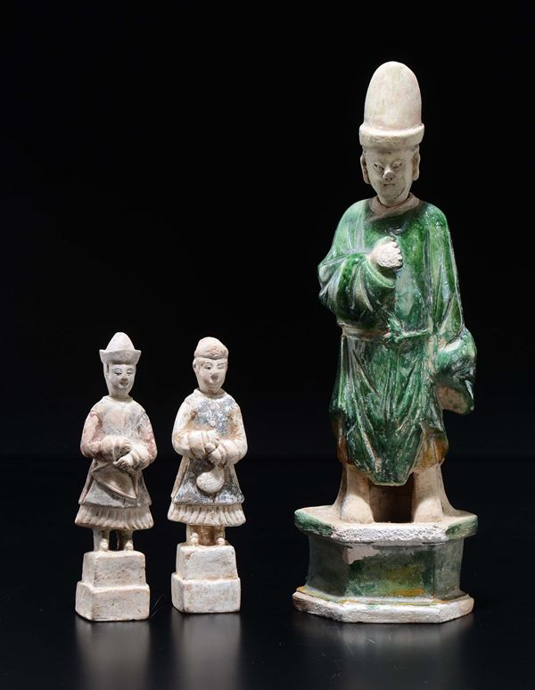 Three painted pottery figures of dignitaries, China, Ming Dynasty, 17th century