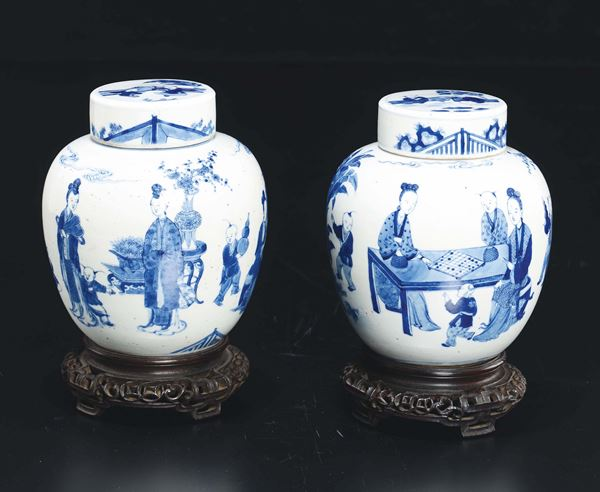 A pair of small blue and white potiches and cover depicting playing figures, China, Qing Dynasty, 18th  [..]