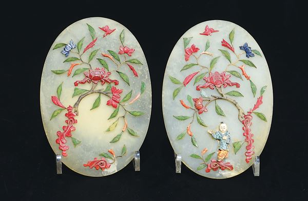 A pair of hardstone plaques with flowering branches and child in relief, China, early 20th century