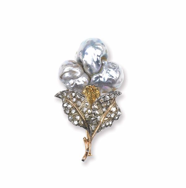 A pearl, gold and silver brooch. Buccellati