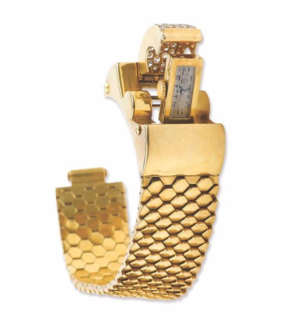 A diamond and gold lady's wristwatch. Van Cleef & Arpels