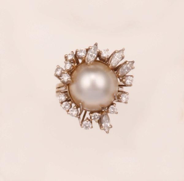 Mabè pearl and diamond ring mounted in white gold