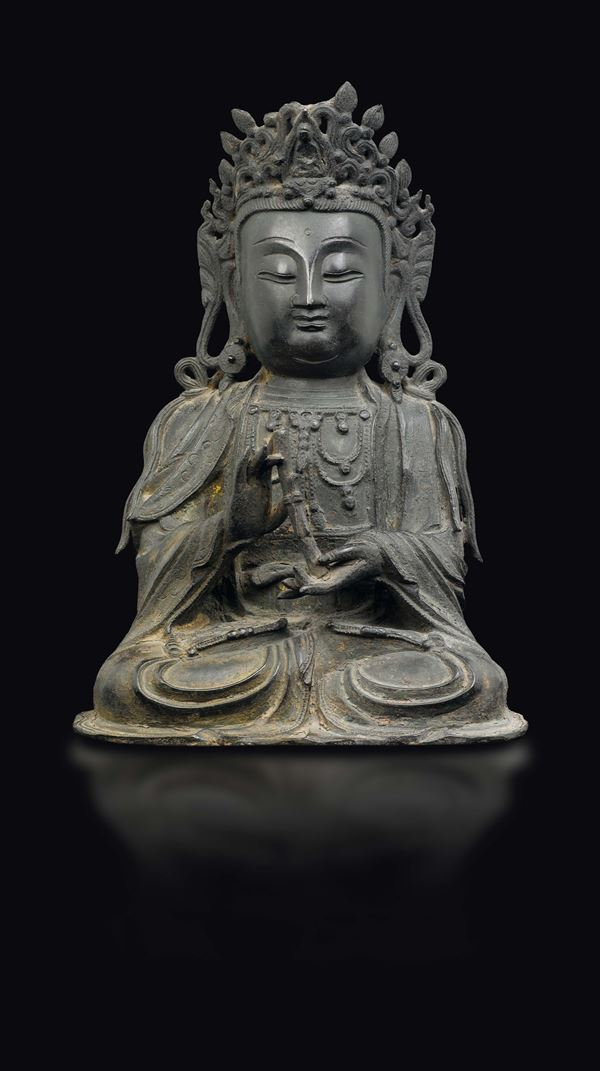 A bronze figure of seated Guanyin, China, Ming Dynasty, 17th century
