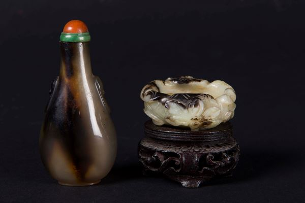 A small white and russet jade brush washer and an agate snuff bottle, China, Qing Dynasty, 19th century